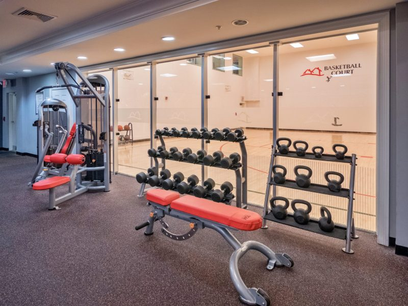 This image shows the fitness gym of TGM Anchor Point Marina featuring the kettlebell and dumbell. It's also accessible to the indoor basketball court.