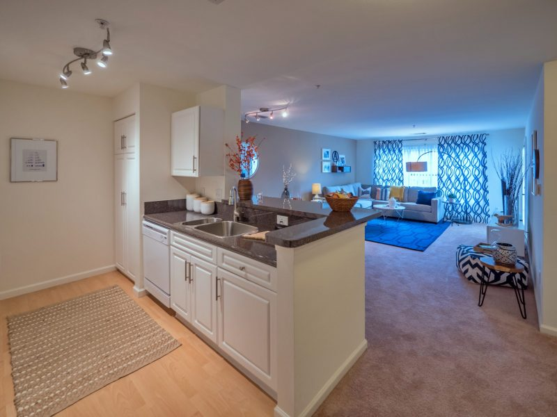This image shows the breakfast bar accessible is for both the living room and dining area.