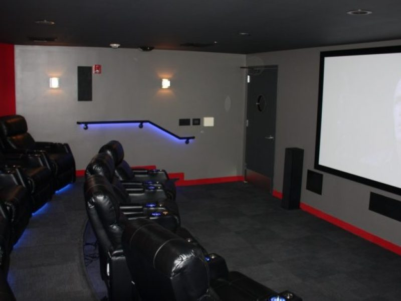 This image shows the Media Center of TGM Anchor Point with theater seating that is good for friends and family to bond with.